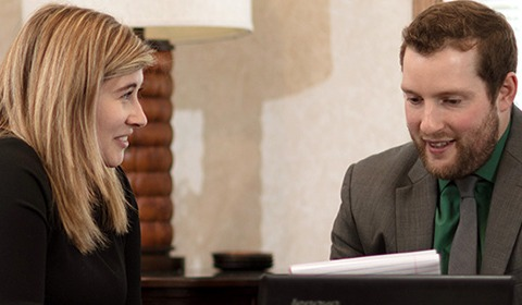 a financial planner speaking with a client